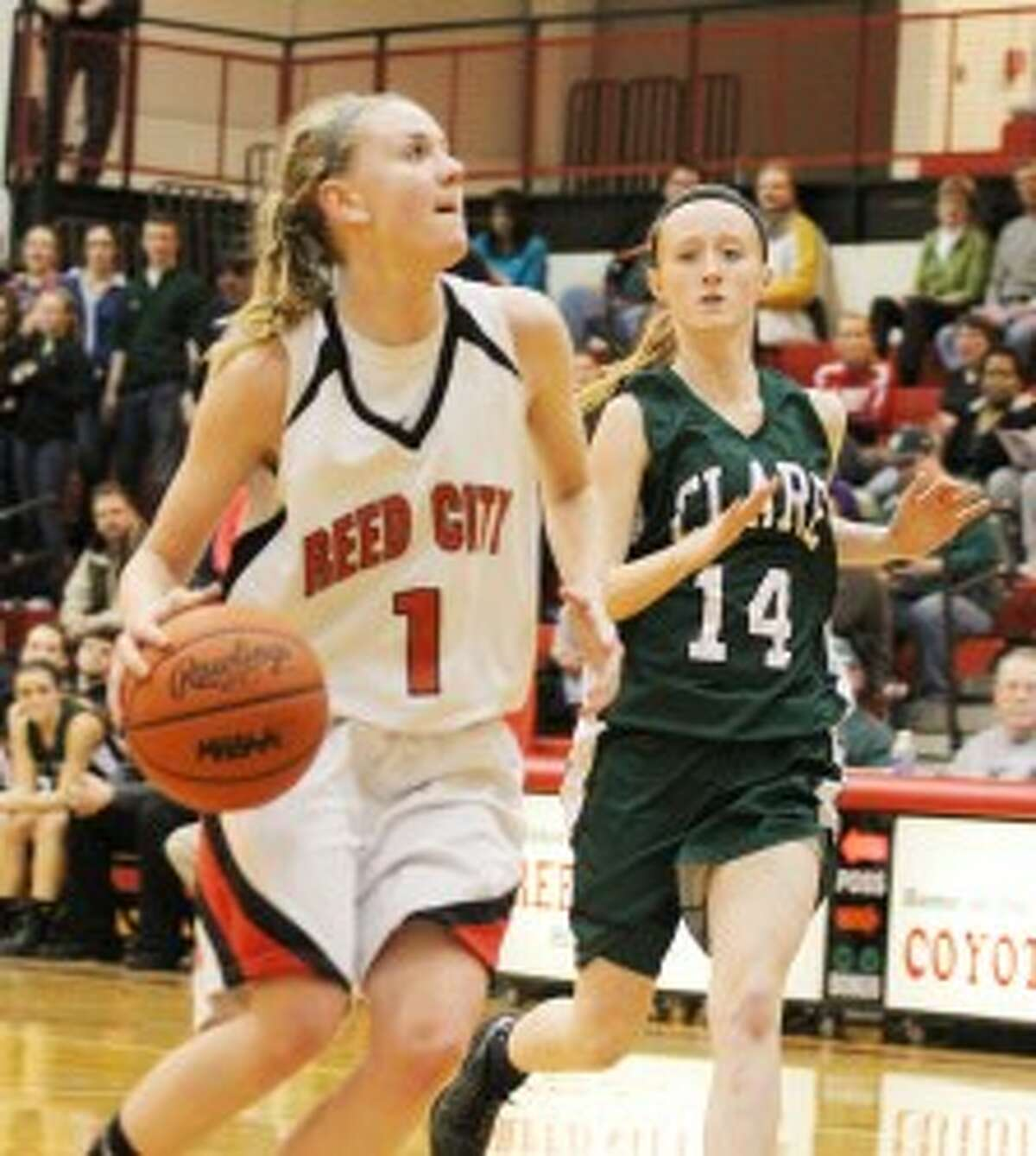GOING UP: Reed City's Emma Lockhart goes in for a lay-up against Clare in district semifinal action on Wednesday. (Pioneer photo/Martin Slagter)