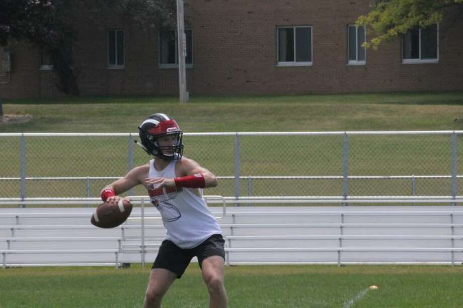 Jackson Price gets set to pass the ball at a Ferris passing camp.