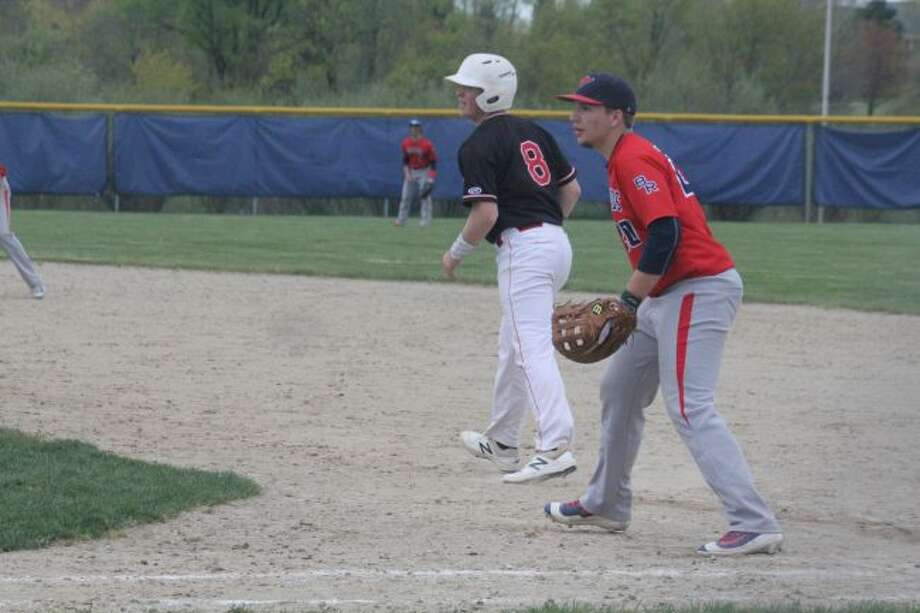 Jeff Phenix leads off first base against Big Rapids.