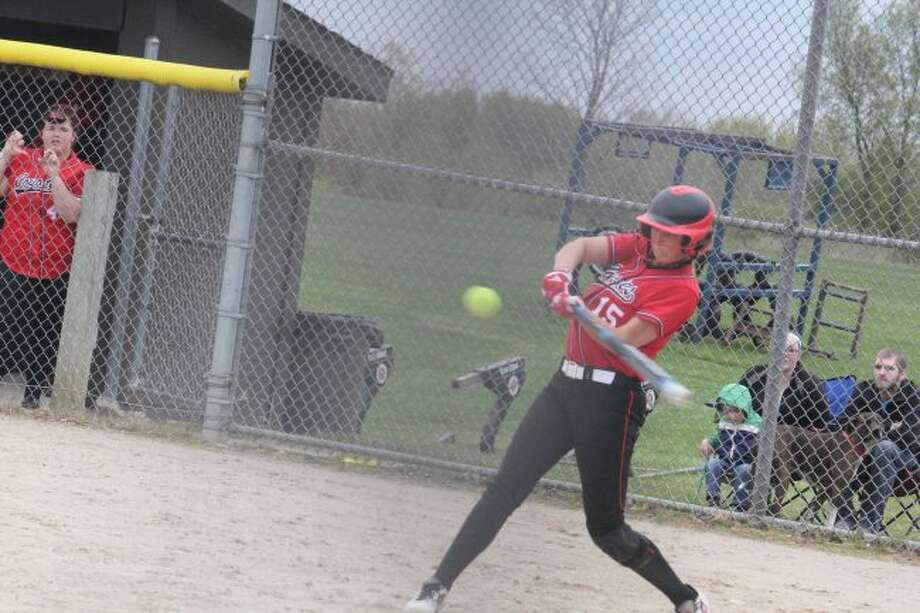 Sidni Rushford swings at a pitch for Reed City.