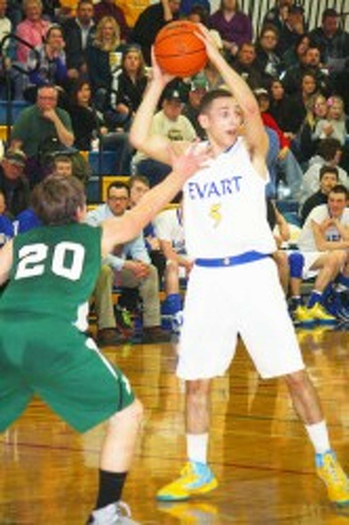 SEASON FINALE: Nate Struble looks to make a pass for Evart against Pine River. (Herald Review/John Raffel)