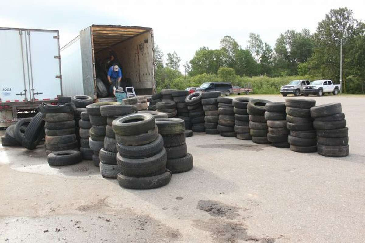 Officials in Middle Branch Township load tires during a 2017 collection day. Similarly, the Osceola-Lake Conservation District will host a tire and electronic collection day on Saturday, July 21, at Recycle of Osceola County. (Herald Review file photo)