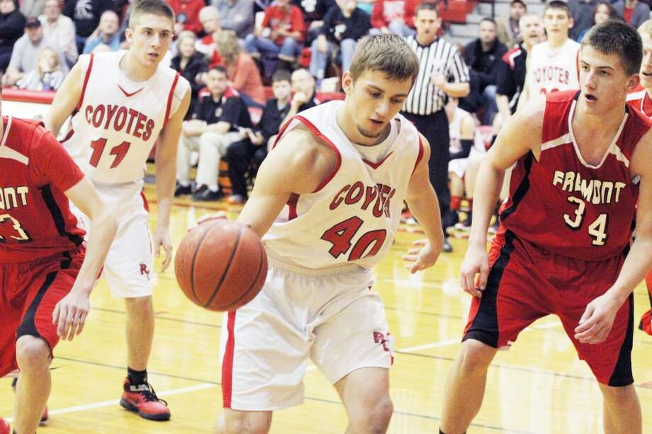 READY FOR DISTRICTS: Jacob Vincent (40) of Reed City looks to make his next move to the basket. (Herald Review/Martin Slagter)