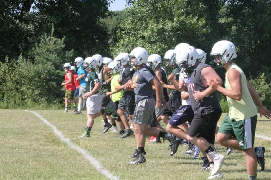 Pine River football players get ready for a practice with some drills.