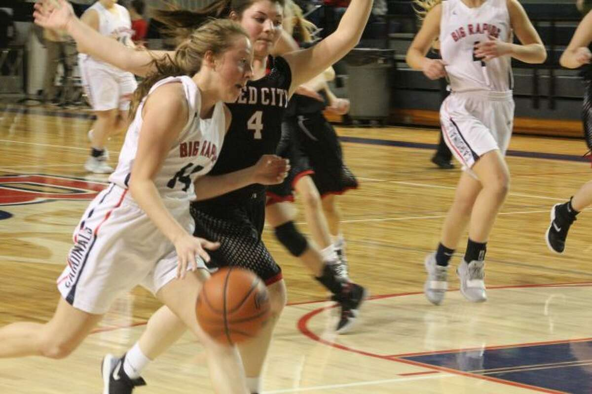 Maddie Morgan (4) plays defense for Reed City/