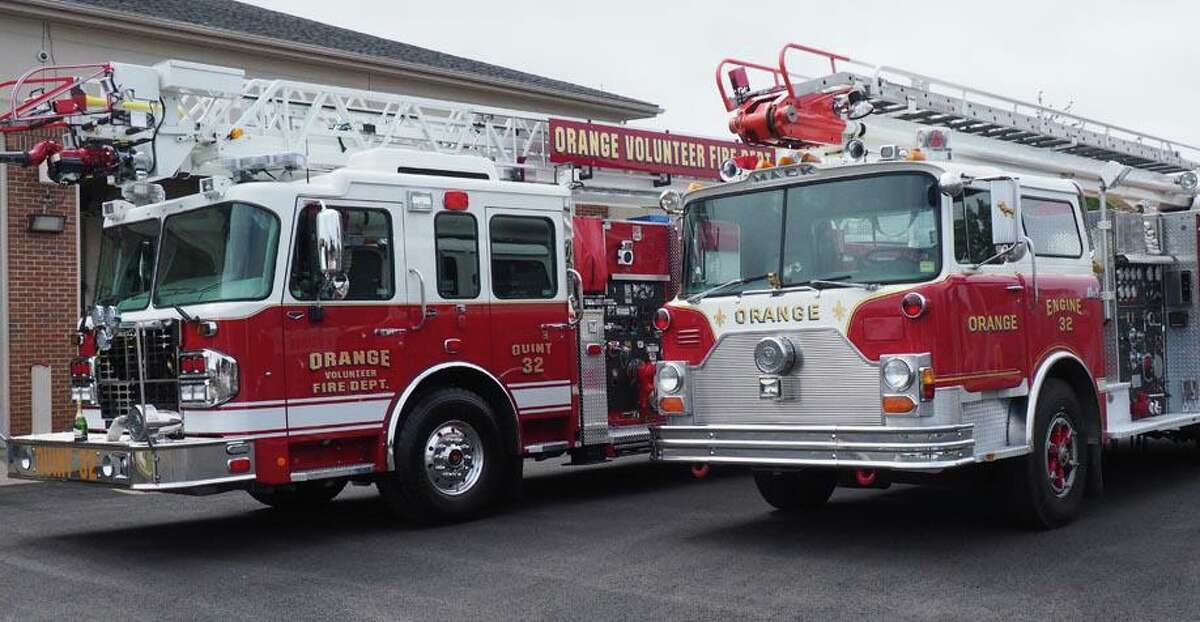The new truck and the old fire engine it is replacing.