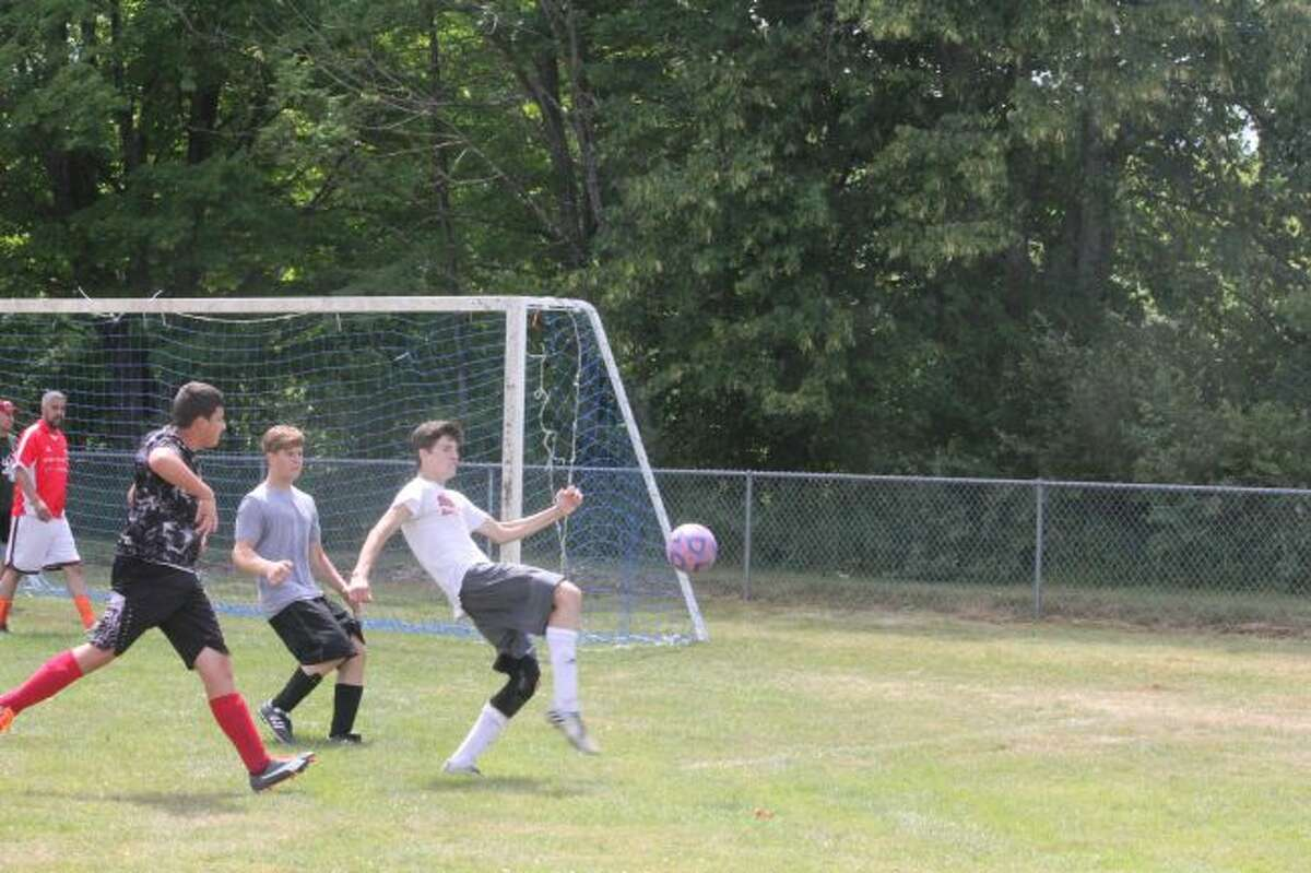 Pine River soccer players work out at camp.
