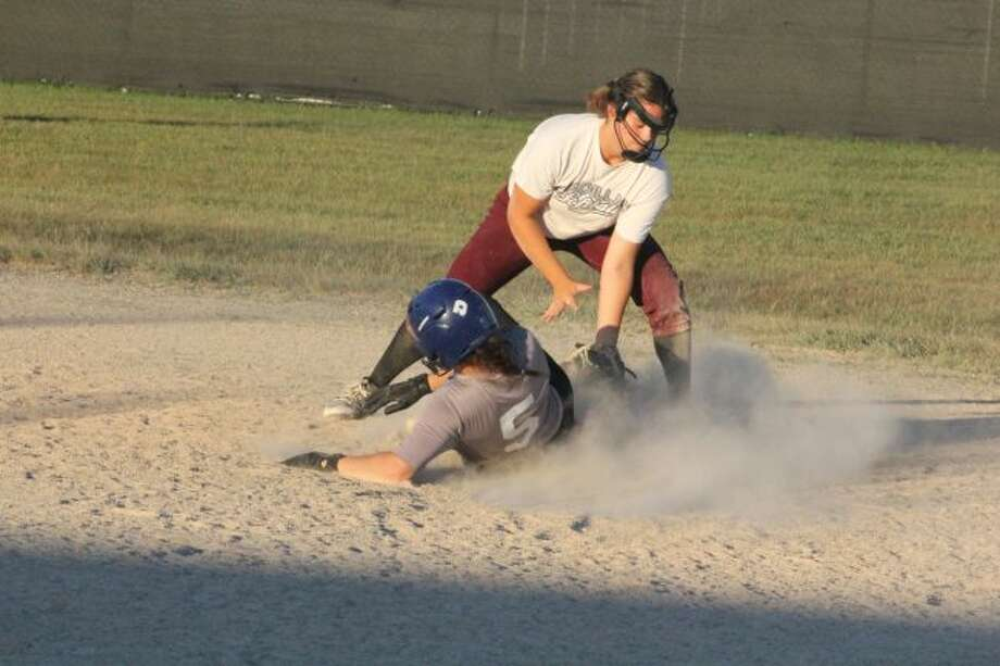 Maddie Morgan slides into second base in recent action.