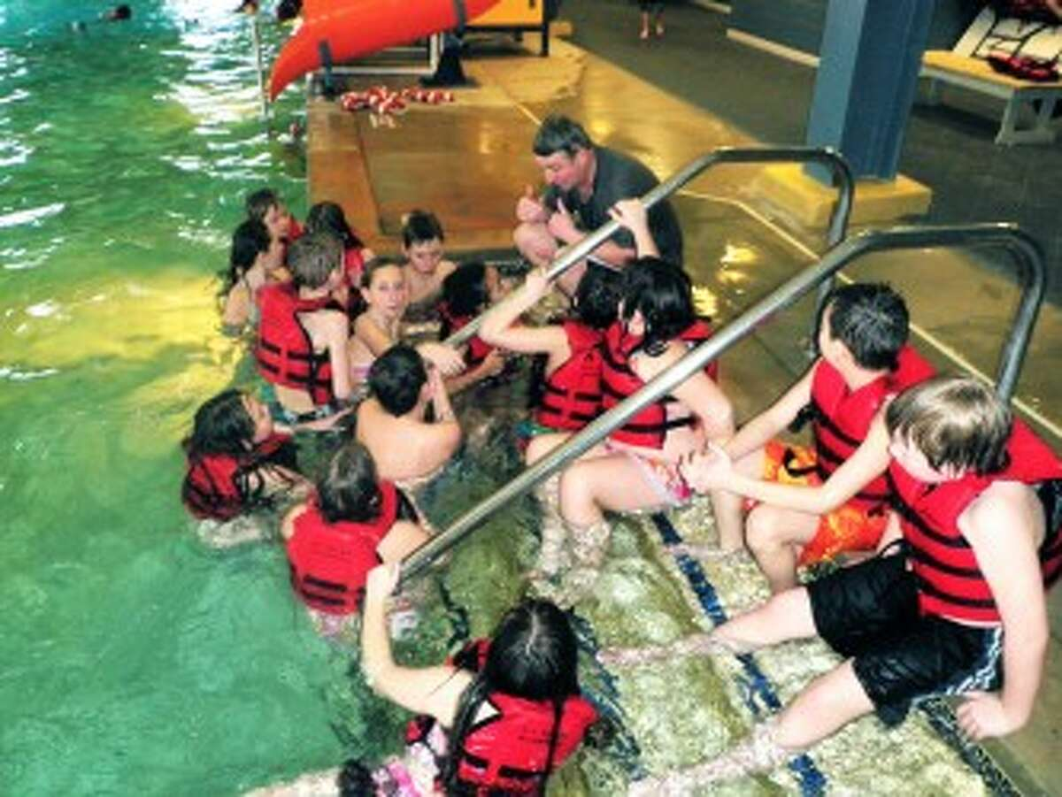 IMPORTANTINSTRUCTIONS: Marcie Hammond's 4th grade class gets instructions from gym teacher Doug Emington before hitting the water while visiting SpringHill camps.