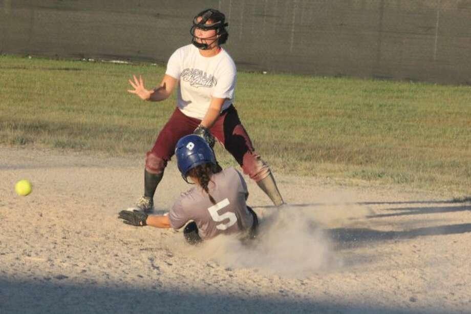Maddie Morgan slides into second base.