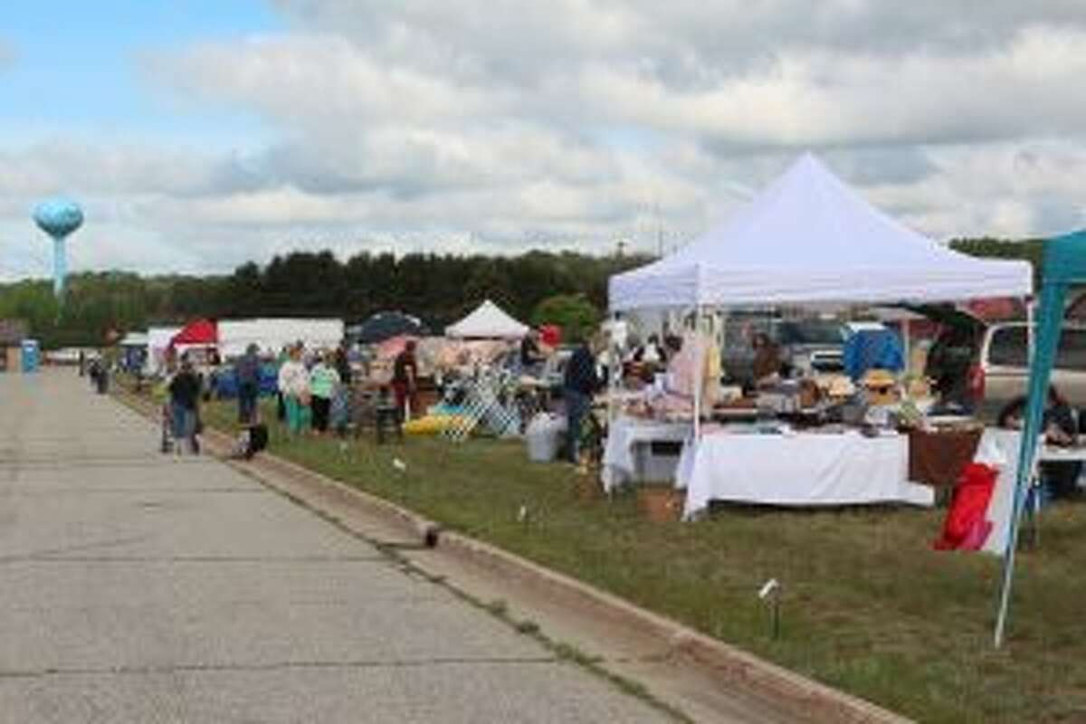 SOMETHING FOR EVERYONE: Dozens of vendors line the Evart Municipal Airport on May 26 as the annual Evart Chamber Flea Market opened.