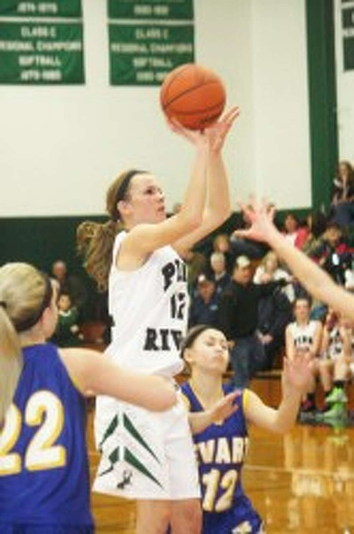 IMPROVED: Jamie Justin (12) was among the all-league players this season for Pine River. (File photo)
