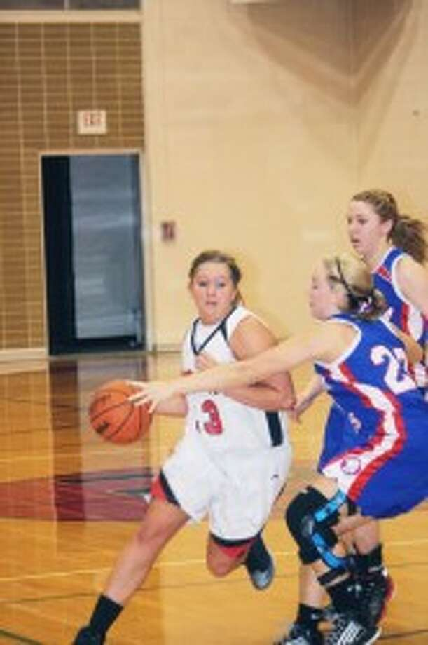 BRIGHT FUTURE: Kalee Hensel (33) will be playing college basketball at Olivet. (File photo)