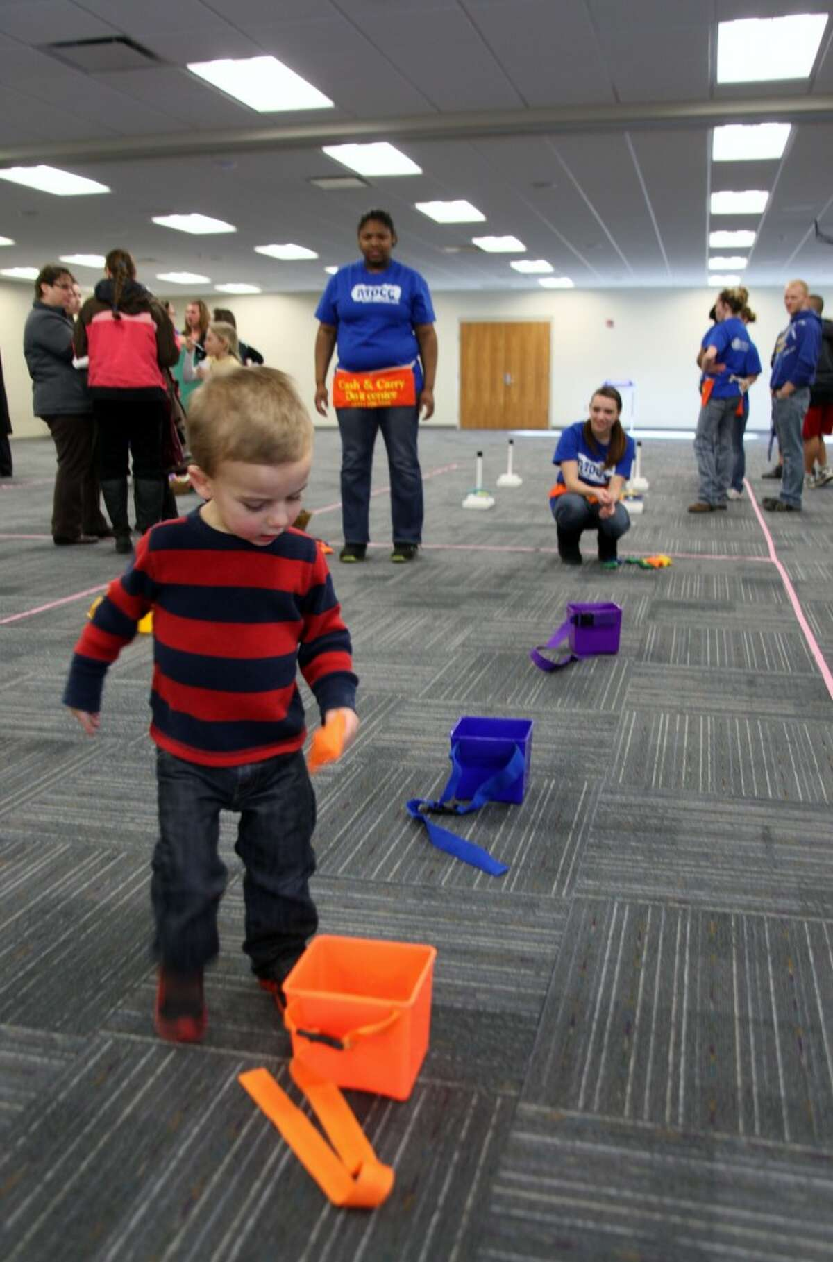REASON TO CELEBRATE: Levi Snyder, 2, plays a game at the Mecosta-Osceola Intermediate School District 50-year anniversary open house on Thursday. His mother, DeAnn Snyder, is a special education teacher for the MOISD. (Pioneer photos/Lauren Fitch)