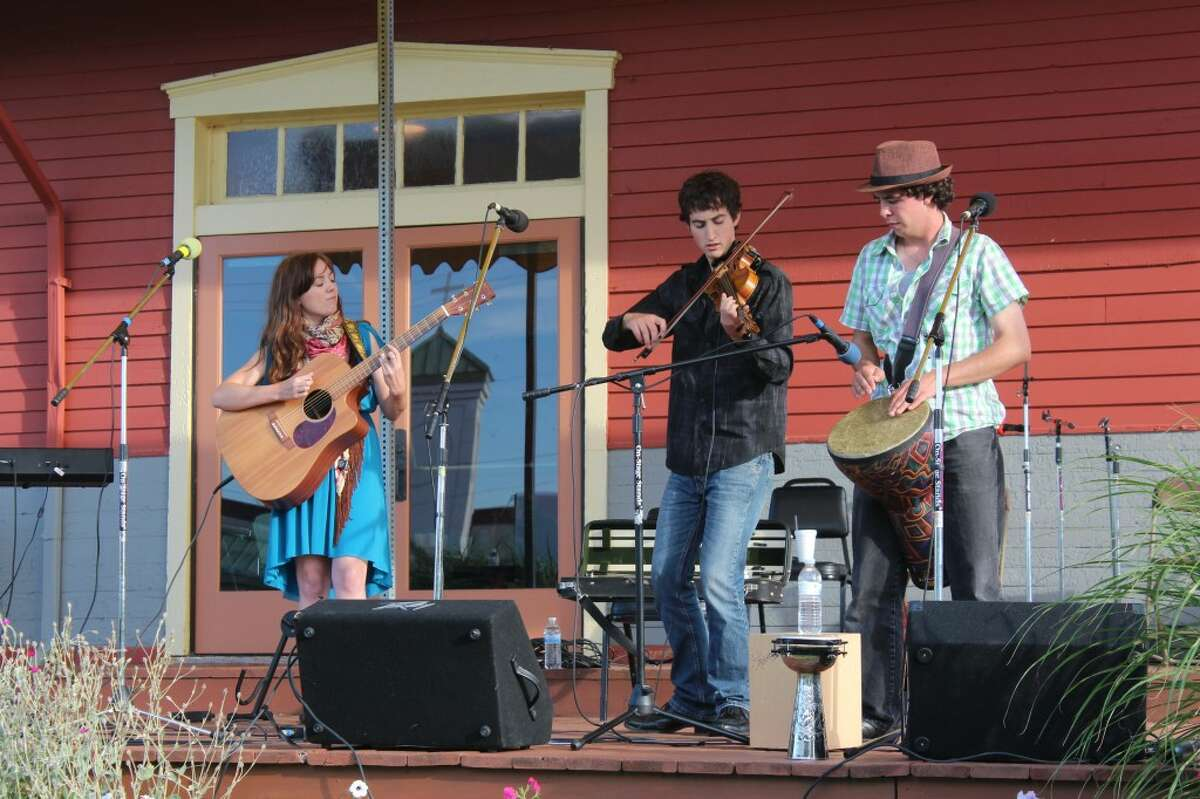 CELTIC FAVORITES: Gasta, a celtic band from Hart, Mich. plays songs and tunes on Saturday at the Evart Depot. Pictured, from left, is Jennifer Versluis on guitar.