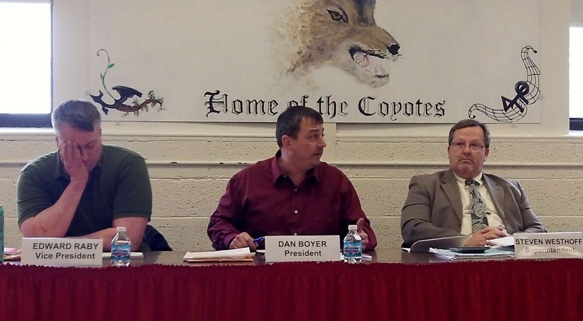 OPEN EVALUATION: Steve Westhoff, (right) superintendent and high school principal for Reed City Area Public School District, requested the board of education complete an evaluation of his performance as high school principal in an open meeting on Tuesday. (Pioneer photo/Lauren Fitch)
