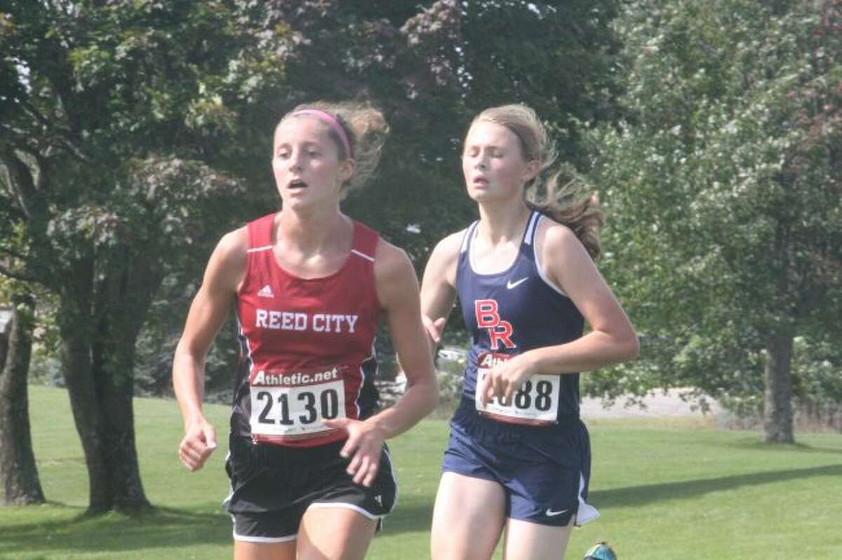 Reed City's Taylor Harrison (left) heads to the finish line at Katke Golf Course/