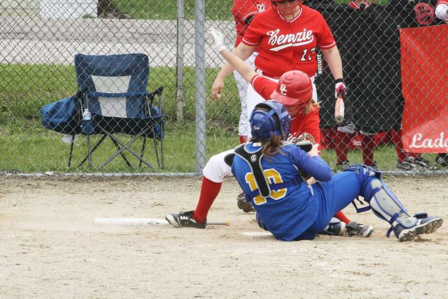 START OF A NEW SEASON: A familiar past scene at Evart's softball field is the dramatic play at the plate between the Wildcat catcher and Benzie Central. Evart has a new coach with Tracy Gray this season. (File photo)
