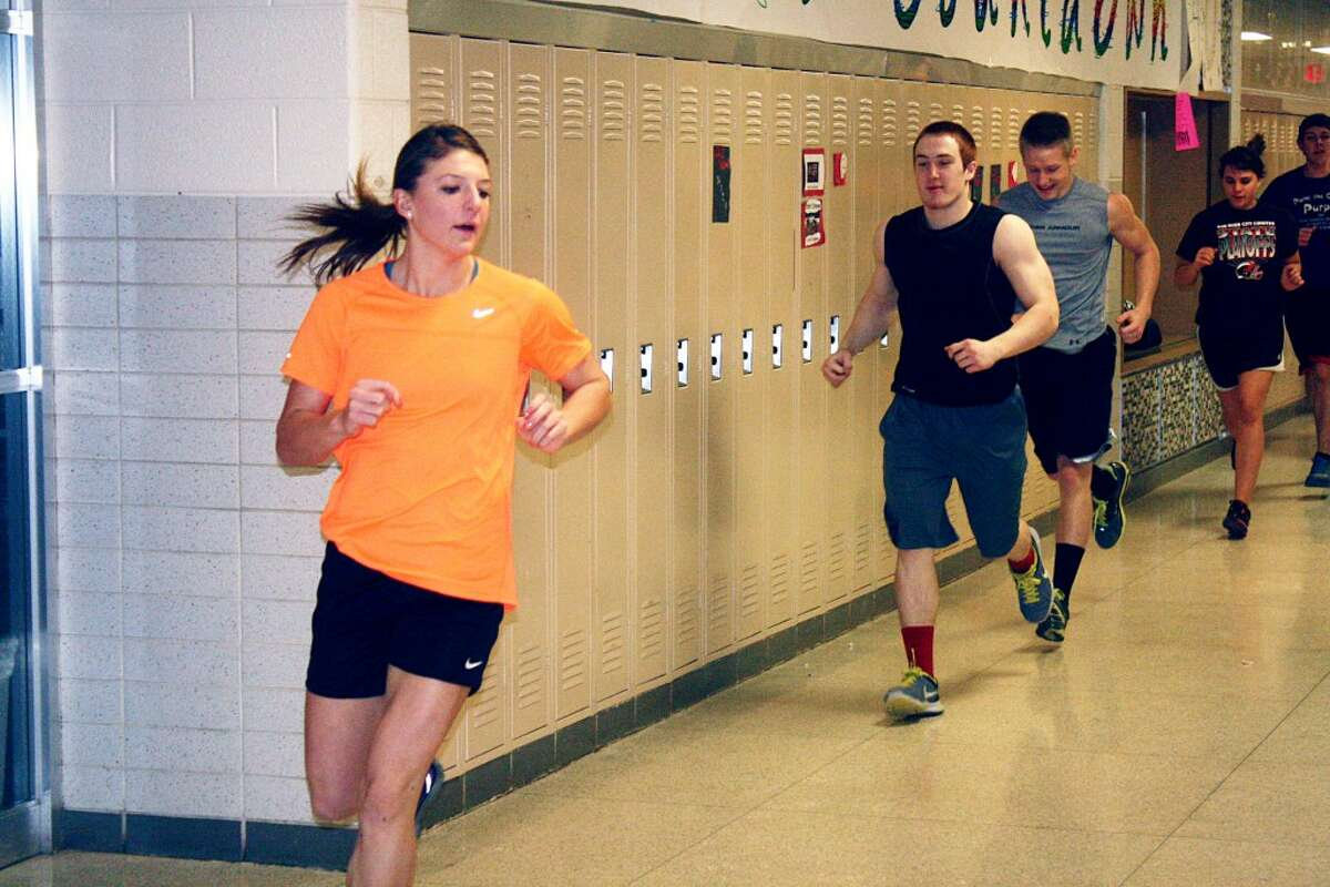 WORKOUT: Sami Michell leads workouts for the Reed City track teams in the high school hallways during a recent practice. (Herald Review photo/John Raffel)