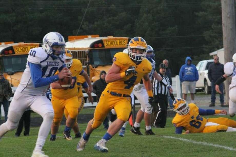 Evart's Justin O'Dell chases the quarterback.
