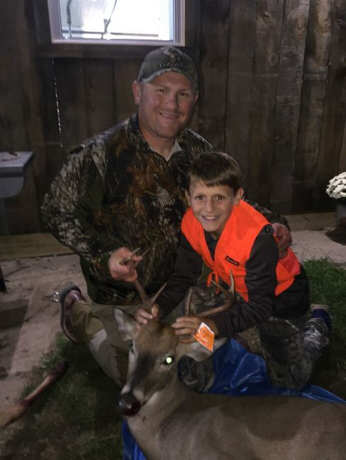 Par Craven (left) and his son show the 8-point buck.