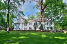 The white colonial house at 202 Georgetown Road sits on a property of 5.5-acres near Devil's Den Nature Preserve.