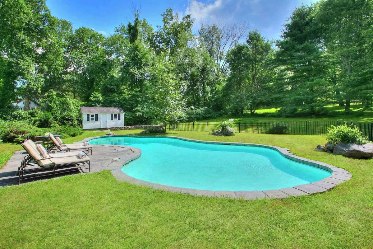 The property contains a heated Gunite in-ground swimming pool with a cabana.