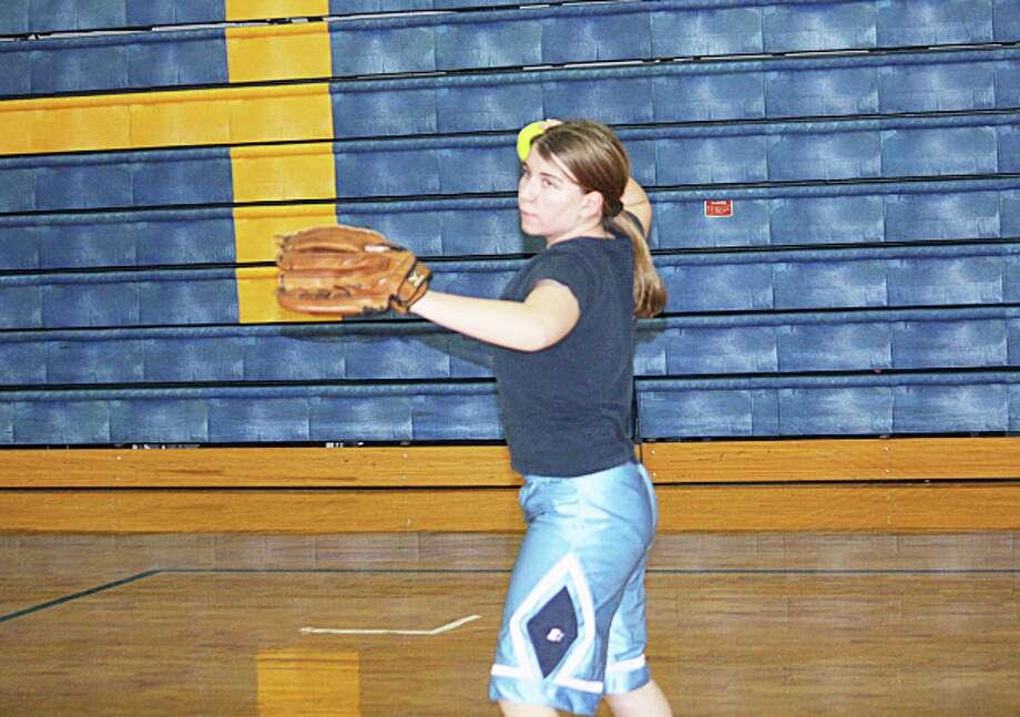 WARMING UP: Sam Bressler works on her throwing during an Evart softball practice last week. (Herald Review photo/John Raffel)