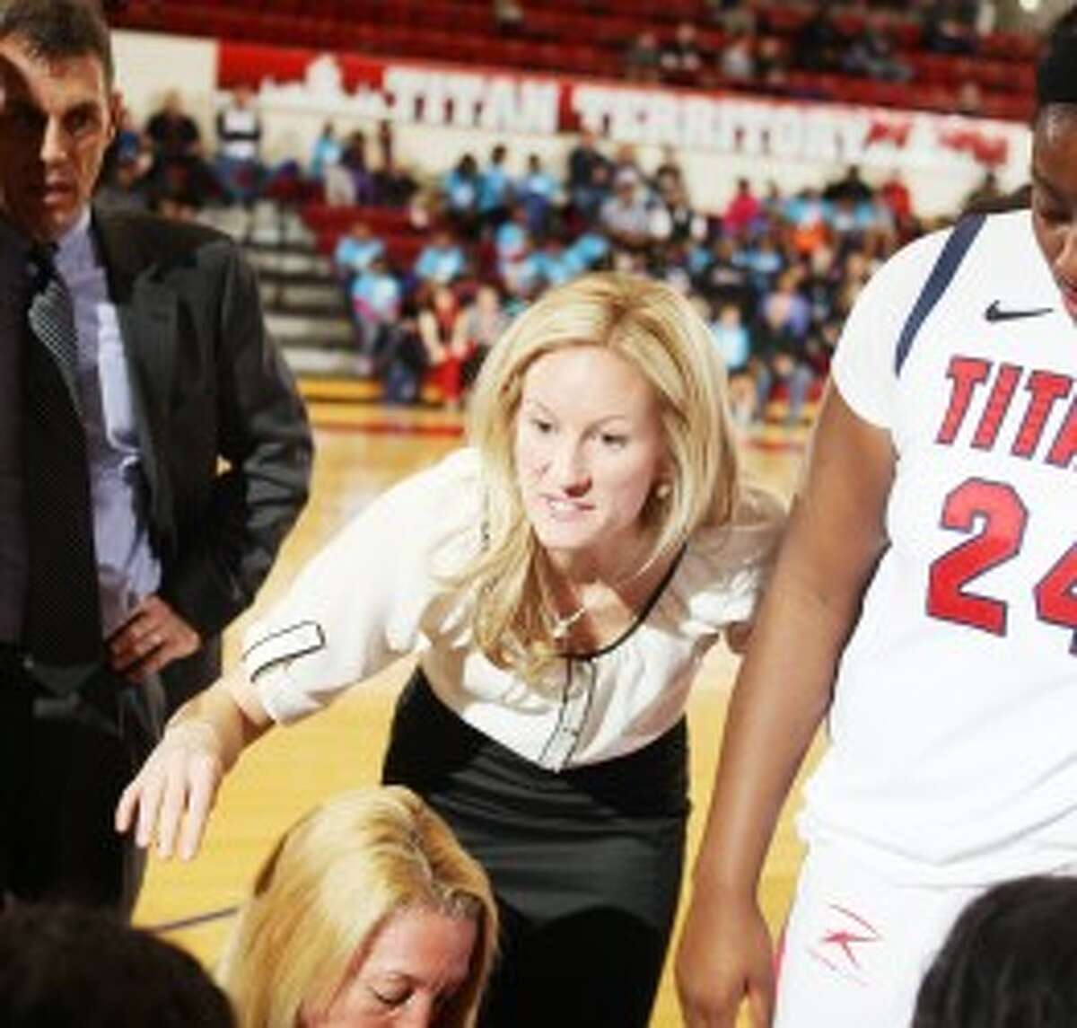 SPEAKING OUT: Emily Geary addresses a player during a timeout earlier this season as an assistant coach at University of Detroit-Mercy. (Courtesy photo)