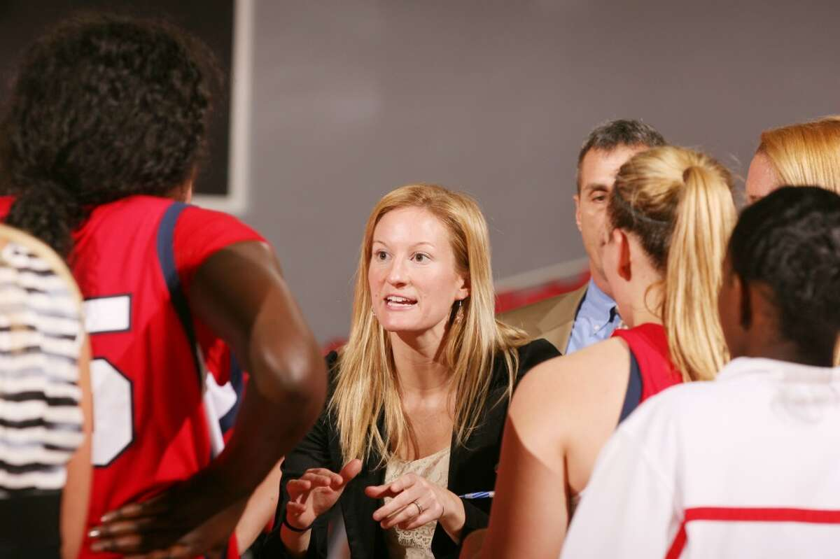 SUCCESSFUL CAREER: Reed City native Emily (Samuelson) Geary talks to the Detroit-Mercy basketball team during a timeout this season. (Courtesy photo)