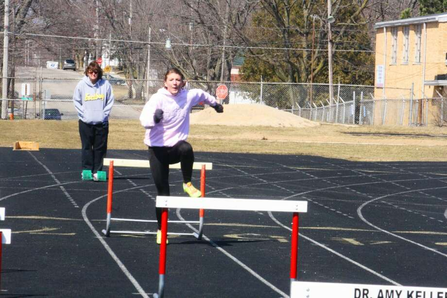 WARMING UP FOR THE SEASON: Sami Michell practices the hurdles during a workout last week. (Herald Review/John Raffel)