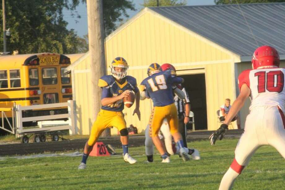 Carter Pritchard looks for a receiver against Holton.