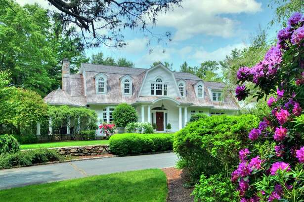 The white custom-built Nantucket-style colonial house at 87 Easton Road sits on a 2.25-acre estate.