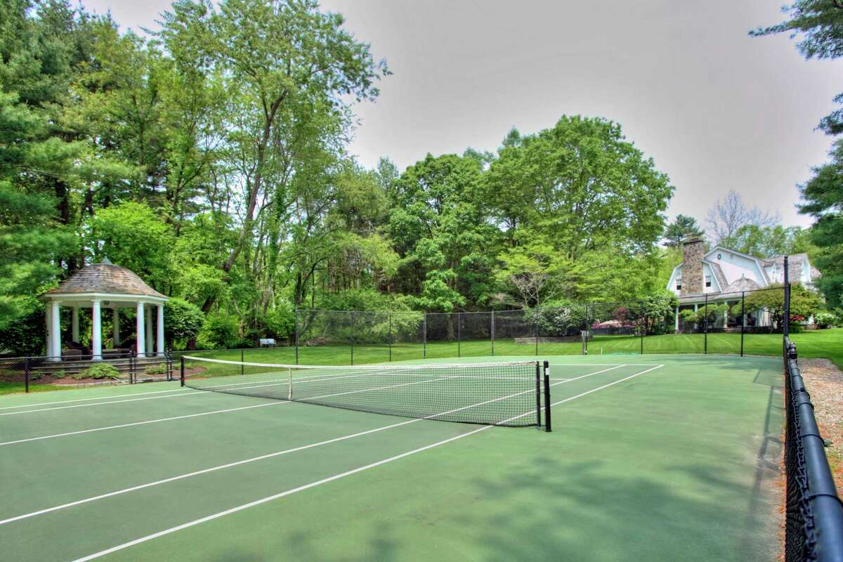 This property has a tennis court and a gazebo from which to watch friendly matches.