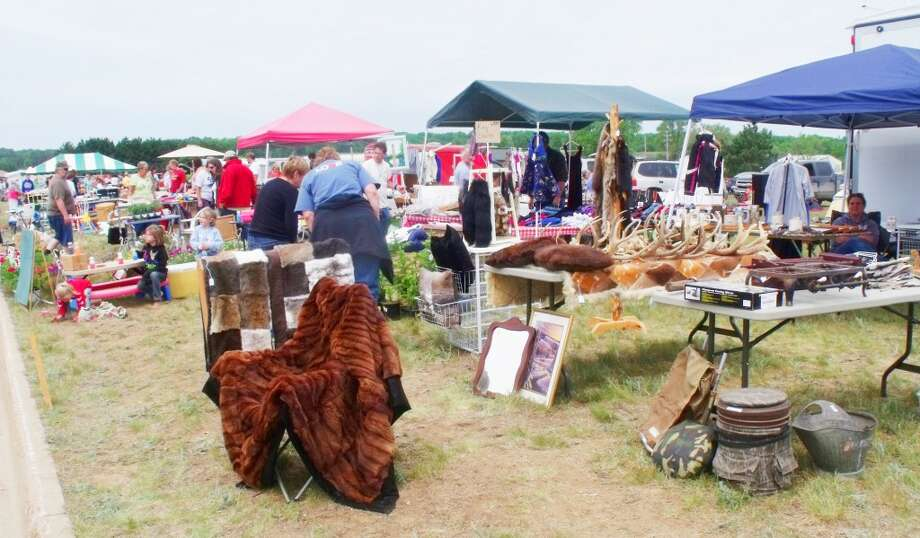 GREAT BUYS: Thousands attended the Evart flea market last summer. (File photos)