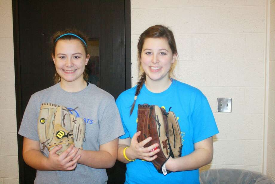 READY TO COMPETE: Allyson (left) and Brittani Yarger are sisters who are playing on the Reed City varsity softball team this spring. (Herald Review/John Raffel)