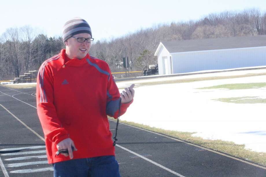 CHAMPIONSHIP GOALS: Eric Gebhard, left, works with his Pine River track team during a recent practice. (Herald Review/John Raffel)