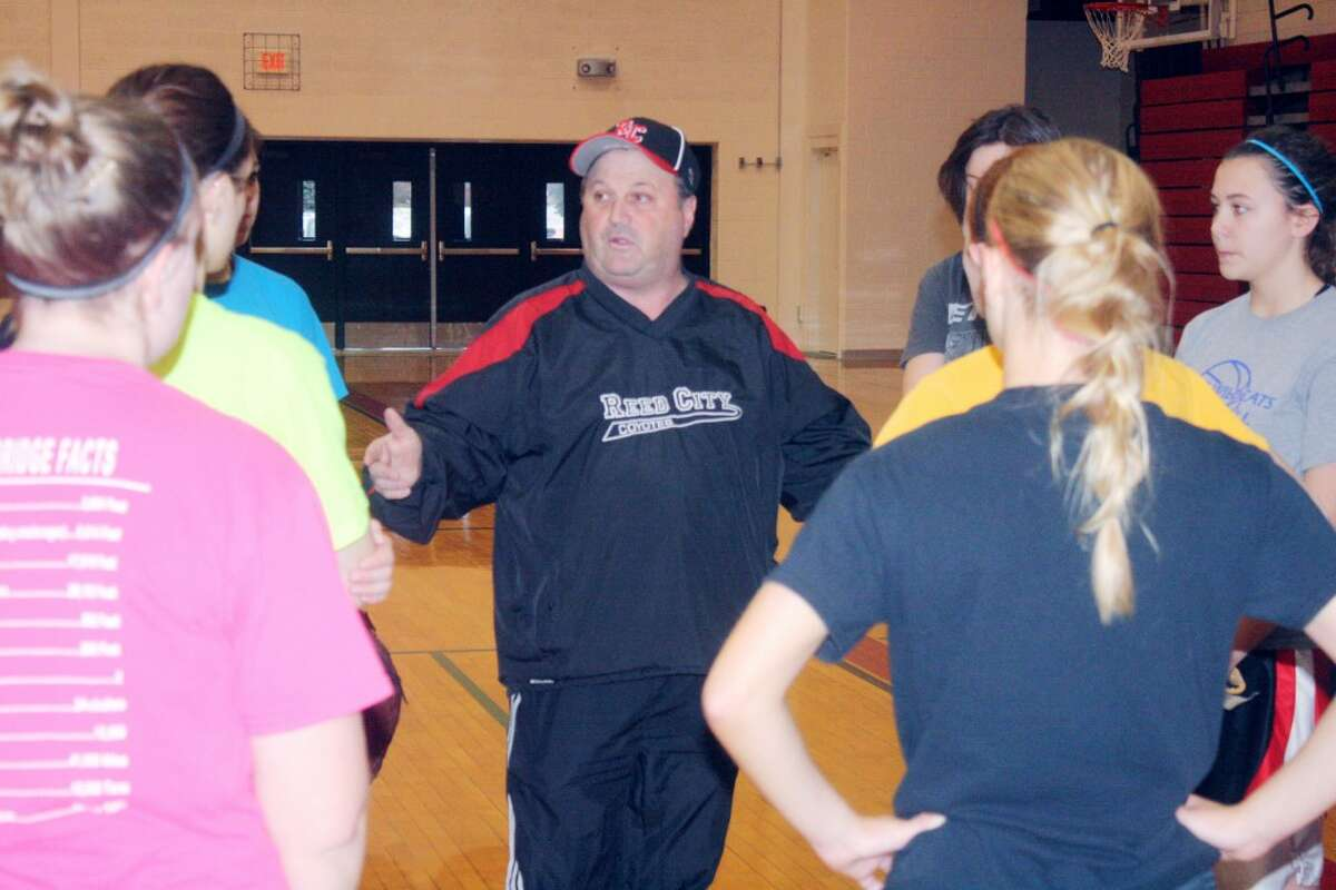 DOING THEIR BEST: Roger Steig talks to his players during an indoor Reed City softball practice. (Herald Review/John Raffel)