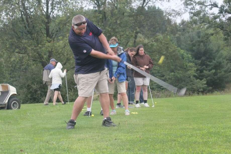 Bill Lapp of Florida connects with the ball at Spring Valley during a clinic for blind golfers/cyclists.