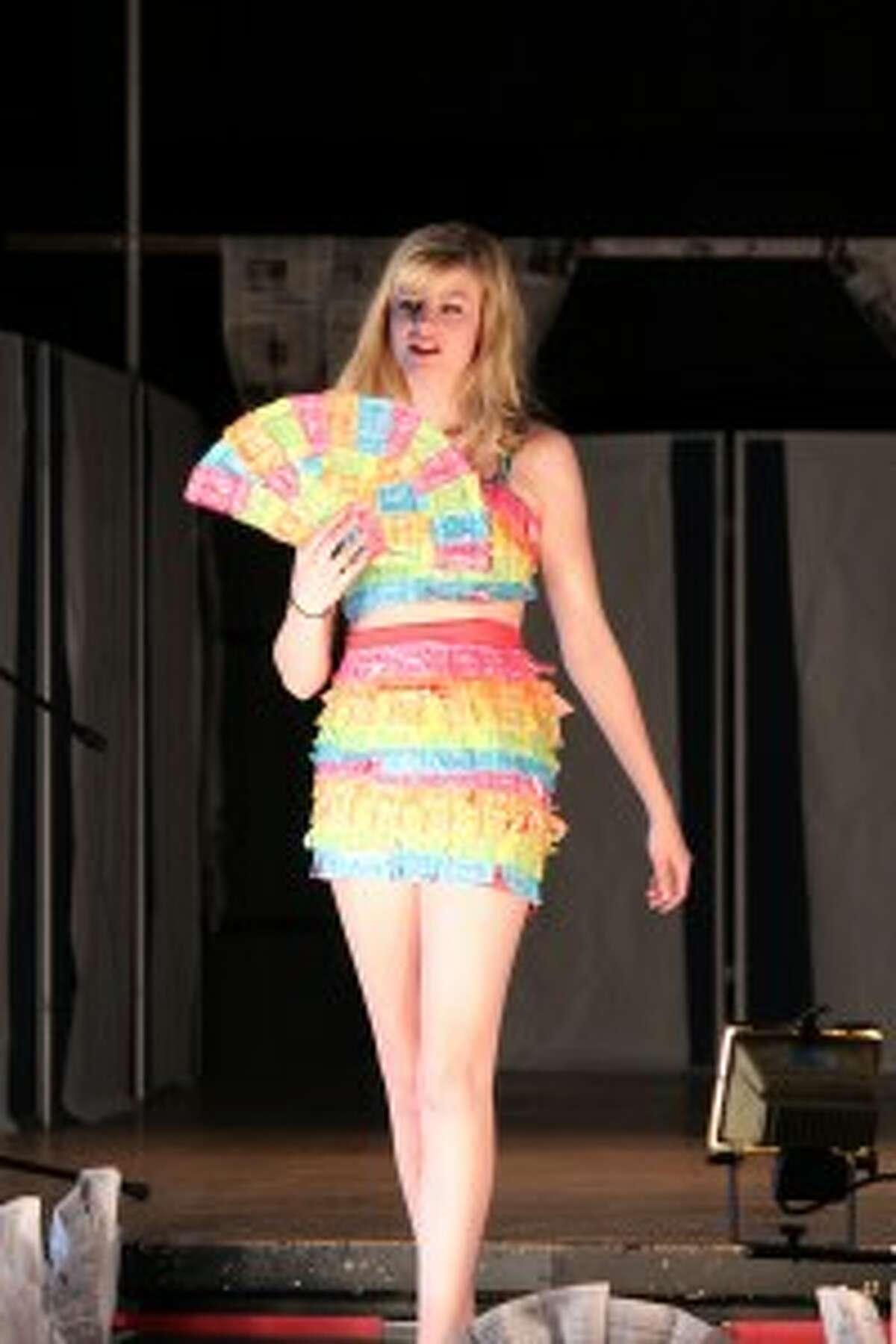 UPCYCLE: Tyler White's colorful crop top and skirt ensemble, modeled by Elizabeth Quinn, is made from flavored tootsie wrappers.
