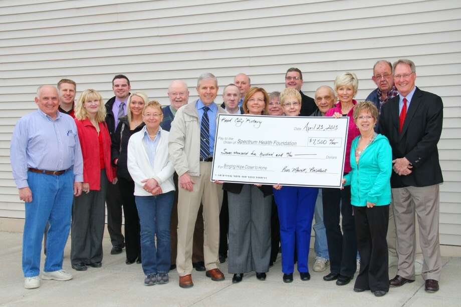 SHOWING THEIR SUPPORT: The Reed City Rotary Club recently donated $7,500 to the Susan P. Wheatlake Regional Cancer Center. The gift is the club's largest single donation in five years.