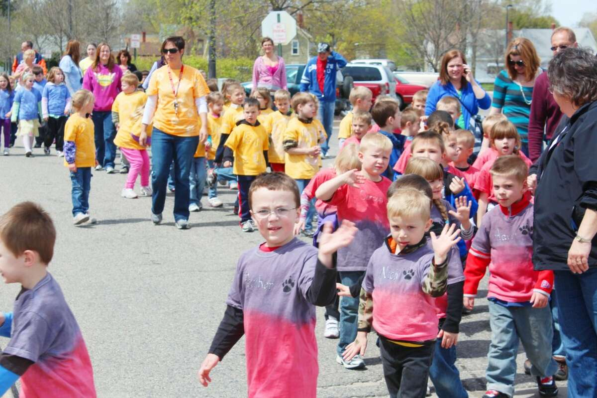 SUPPORTING CHILDREN: Hundreds of students wore colorful t-shirts and walked in last year's Reed City Children's Parade. (File photo)