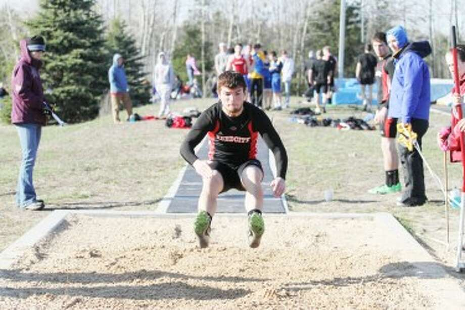 HAPPY LANDING: Reed City's Eric Bradford prepares to land in the long jump during Wednesday's conference track meet at Morley Stanwood High School. (Pioneer photo/Greg Buckner)