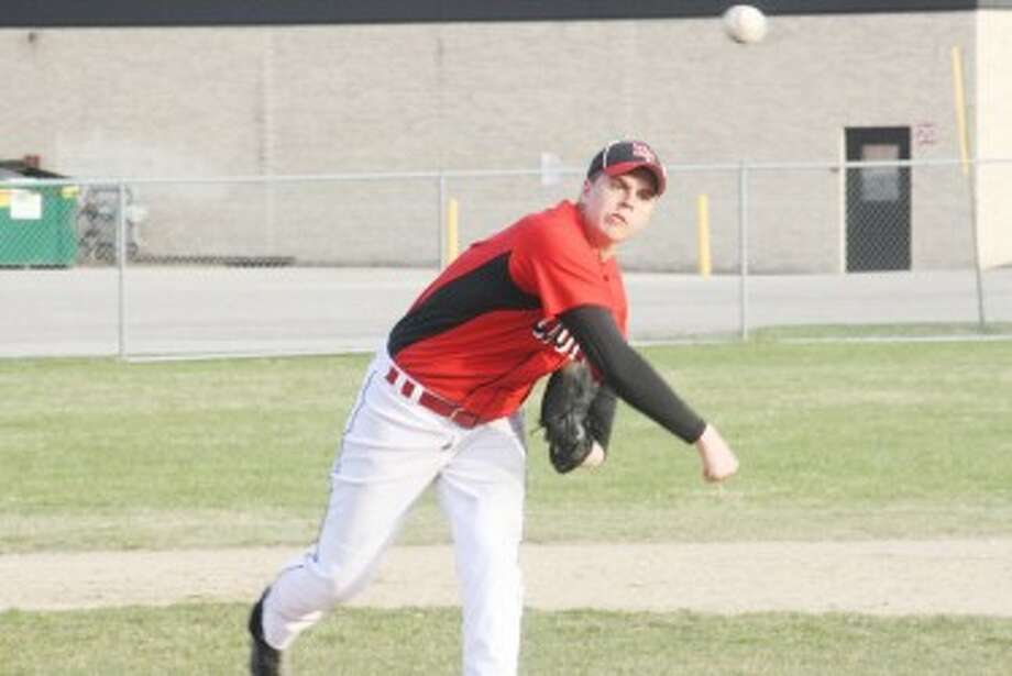 ON THE WAY: Reed City's Ryan Willis fires in a pitch during Friday's action against Lakeview. The coyotes dropped both games of the doubleheader. (Pioneer photo/John Raffel)
