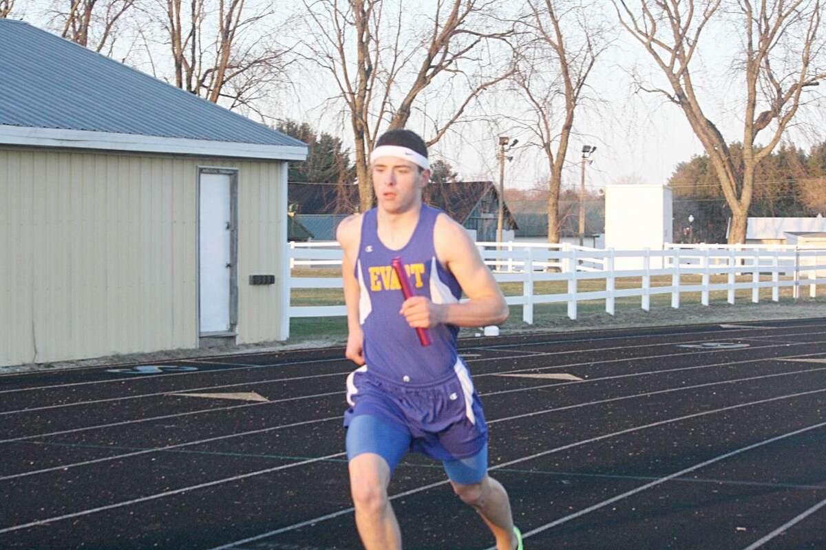 RELAY DASH: John Danley runs his leg of the 1,600-meter relay last week. (Herald Review/John Raffel)