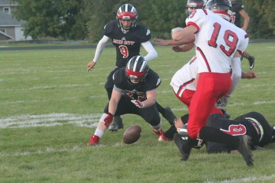 Reed City's Matt Bush goes after a fumble against Fremont.