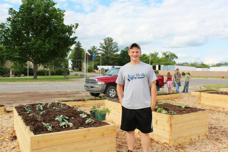 Beautiful and practical: Thanks to Nathan Renne and his hard work, as of last year, Evart has become of the many cities in Michigan to have a community garden. The raised bed plots will be available at no cost to community members for growing vegetables and flowers. (File photo)