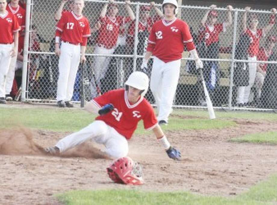 SAFE: Chippewa Hills' Nolan Denslow slides into home during Tuesday's doubleheader against Reed City. (Pioneer photo/John Raffel)