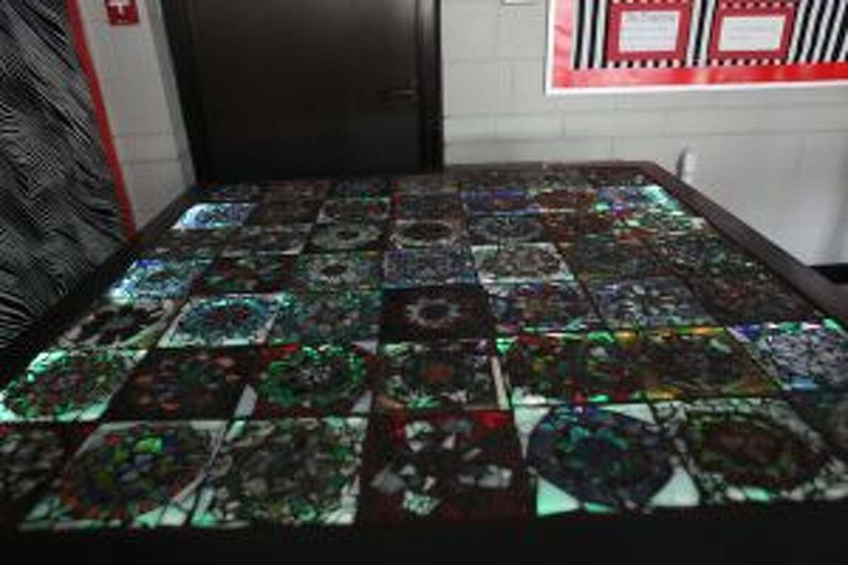 The artwork, Cultural Diffusion, is currently hanging and illuminating West Grand Neighborhood Organization, located at 415 Leonard St. NW, Grand Rapids, for the duration of ArtPrize. LED lights were used to brighten each of the mandalas with different colors.