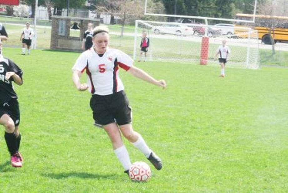 SOCCER: Makenzie Switzer (5) takes the ball down the field for Reed City against Newaygo. (Herald Review Photo/John Raffel)